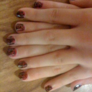 red and black diagonal nails with swirls - red on black and black on red