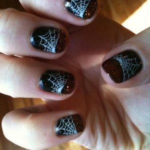Halloween nails!! Black Pool with BM spiderweb stamp with white Konad, plus orange glitter on the tips...