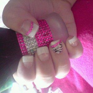 white tip acrylics, zebra print ring finger and pink rhinestones
