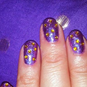 Purple Rockstar nails with Gold Swarovski crystals for a Las Vegas party night! They are actually very purple this picture doesn't do them justice!