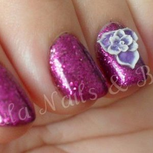 Gelish Star Burst with pure purple glitter on top, also known at Rockstar nails, I also added some 3D flowers too