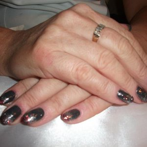 Shellac Asphalt with red and silver glitter fade