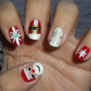 My 'Festive' themed nails, They are Gelish Red Roses & Gelish Sleek White, My thumb and first two fingers are all hand painted and the other two fingers have some little decals on them!