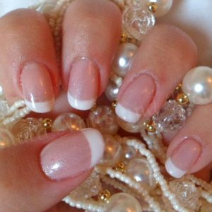 My 'french' look Gelish nails, I done these by applying a natural nail overlay of NSI Purely Pink acrylic and then Gelish Light Elegant and Gelish Sleek White to give me my 'french' look and to also extend my nail beds to give the appearance of longer nails!
