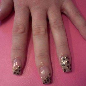 Leopard print nail art on acrylic nails