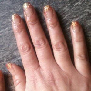 Clear tips with red glitter acrylic on tips.