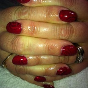 Peekaboo nails - Rockstar layered with Shellac then carved design x