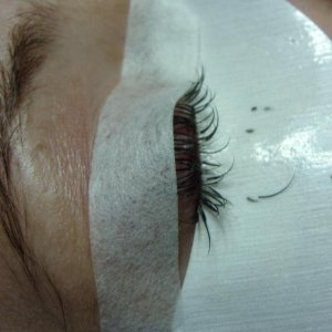 Not a great picture but will give an idea of how to tape up the lashes to expose more natural lashes underneath
