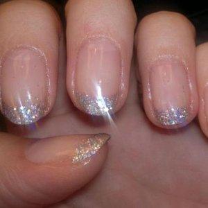 Glitter tips shellac close up.