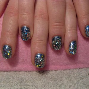 Gelish Ocean Wave over Midnight caller with coarse and fine silver glitter