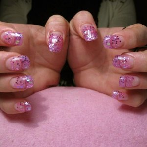 Crazy pink barbie/princess theme nails for prom  GHG over natural tips with pink and white glitter of all sizes and pink metallic beads.