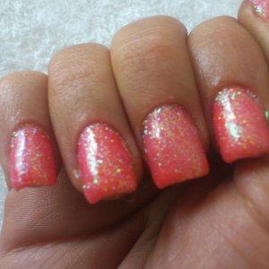 Tropix shellac with a coral glitter love it
