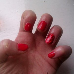 Gelicure with red glitter ring finger