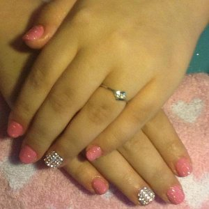 Accent Finger Using Swarovski Crystal AB and ASP Tutti Frutti and Disco Ball Gels.