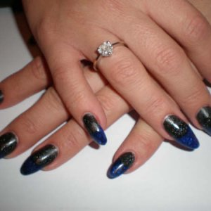 Reverse manicure with black with blue tips