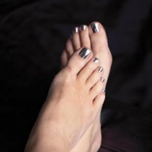 Samantha's toes Minxed by me! First Attempt and they lasted 6 weeks!   Minx Silver Lightning