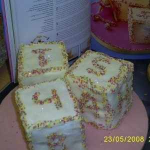 I made this one for Theresa's half sister it was her 1st Bday The blocks spelt out her name and age