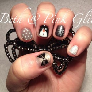 short nails can still look great, winter fun with Konad snowflake, handpainted penguin, glitter, dots and a Konad bow