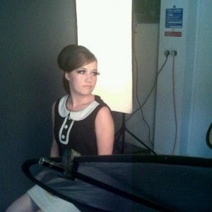 Level 3, College photo shoot:  Theme - 1960's Theme. Shift dress & gogo boots. Exaggerated beehive.