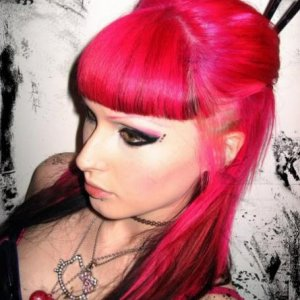 Stargazer hot pink on prelightened hair with black panels and undercut