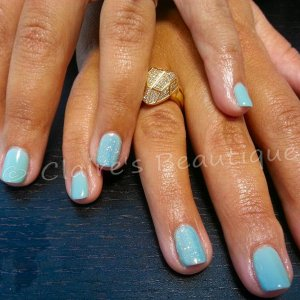 Seafoam with White Iridescent Glitter on ring fingers.