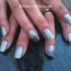 Silver holo glitter over simply sheer with stamping nail art