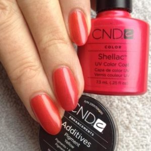 CND Shellac in Hot Chilis with Yellow Pigment Additive. The yellow cuts the blue from Hot Chilis to make it a warm red and not 'pink'. The shimmer in Hot Chilis still shines on through.