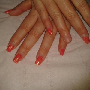 brisa gels with shellac finish, nearly grown off her nails. 6+ wks