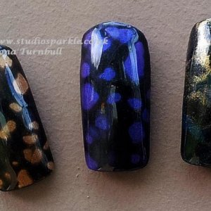 the first two swatches are kind of experimental, i just dropped some D-Sperse on uncured Overtly Onyx.  I am unsure of the longevity of the wear or if this affect Shellac formulation. I will not use this methods on clients.  Shellac black spotted base - cure colour - cure colour - cure additive drops of D-Sperse leave to dry top coat - cure