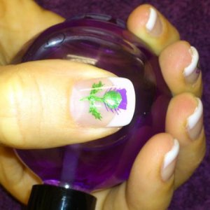 Wee hand-painted thistle