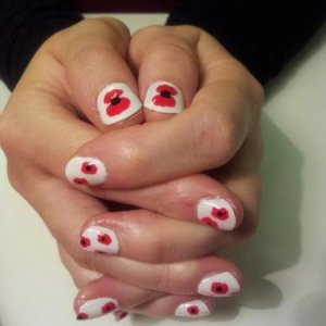remembrance poppy nails, hand painted with shellac.