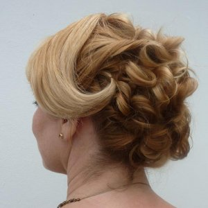 Ruched Hair with side swept after hot rollers