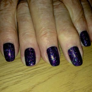 Shellac Blackpool with Purple Stiletto glitter - been on for two weeks!