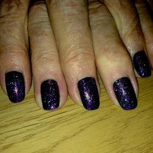 Showing plenty of re-growth but still perfect to party - the infamous Purple Stiletto!