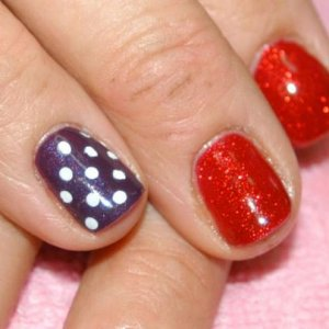 """Shellac in """"Ruby Ritz"""" with ring finger accent nails in """"Rock Royalty"""" with white polka dots"""