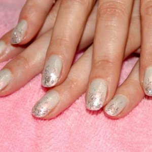 """Shellac mani in """"Moonlight and Roses"""" with """"Mother of Pearl"""" and a silver mylar strip fade over natural acrylic sculpts."""