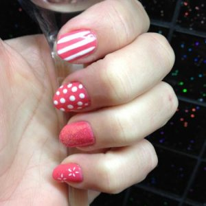 shellac rosebud layered with tropix with a bit of nail art