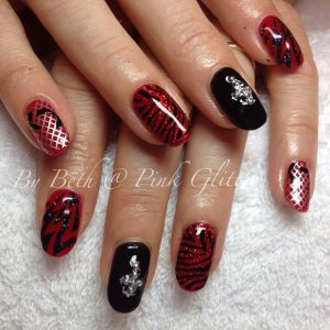 Royal Red and Licorice overlays with studs, gems, loose glitter and stamping for a clients KISS themed nails