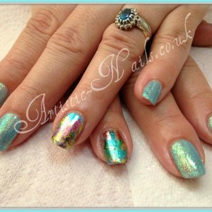Shellac Azure Wish with sea grass additives and foils.