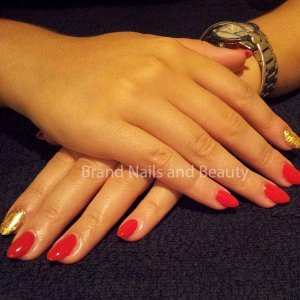 Almond shaped gel extensions with Marachino Cherry Gellux with gold leaf accent nail.