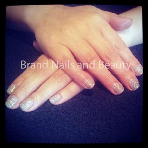 Natural nails with glitter gel manicure.