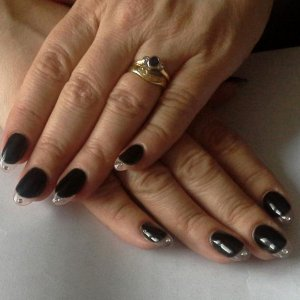 Clear sculpted tips with Blackpool and inlaid crystal.