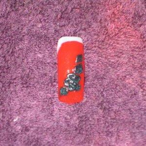 Nails 001 Custom black shimmer acrylic art over OPI Big Apple Red.