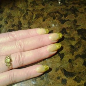 These was done for a 70's glam rock 50th birthday party im going to. I did these on the birthday girl using a made up gold glitter for the tips and NSI yellow and opal shimmer for the nail beds.