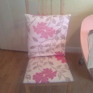 an ikea chair i covered with the material i based my room around, with a cushion.