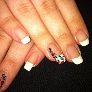 French manicure with leopard print nail art.
