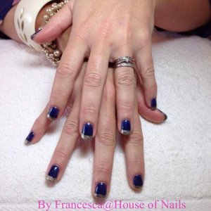 Midnight blue with gold tips.