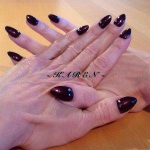 Bio Sculpture natural nail overlays, with Dark Lava Vinylux and gemstone detail.