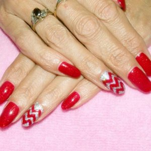 Shellac in Ruby Ritz with feature nail in Shimmering Silver Twinkle Additive and Ruby Ritz chevrons.
