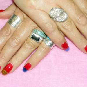 Shellac in Ruby Ritz over Wildfire and straight foil tips in different colours.